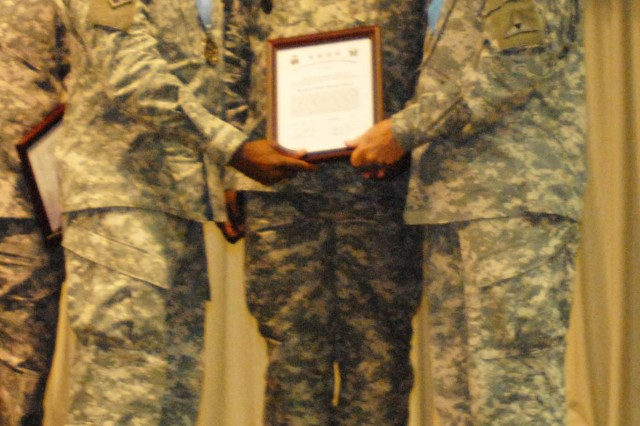 Staff Sgt. Charles R. Spence, Jr. receives a certificate at a Sergeant Audie Murphy Club induction ceremony Mar. 4 at the Phantom Warrior Center on Fort Hood, Texas. (U.S. Army photo by Pfc. Amy M. Lane)