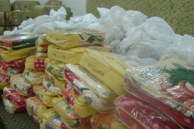Blankets to be distributed to needy families in Muthanna Province, Iraq, are stacked up and ready to be handed out. The event, which gave deprived area families desperately needed supplies, was made possible through the assistance of Company A, 1st Battalion, 77th Armor Regiment, and the Muthanna Provincial Reconstruction Team.
