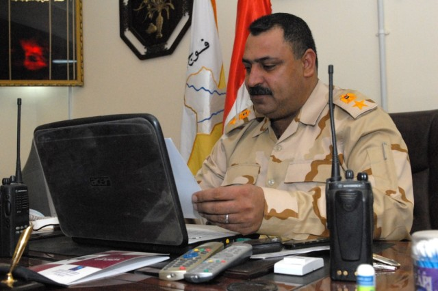 Lt. Col. Salah, commander of the 3rd Battalion, 30th Iraqi Army Division, examines a photograph during a meeting with U.S. Army leaders at the 3rd Bn.'s headquarters in Najaf Province, Iraq, Feb. 23, 2010. Salah, who was responsible for the province's security during the March 7 National Elections, works closely with his U.S. counterparts to take full of advantage of their technology and specialized expertise.