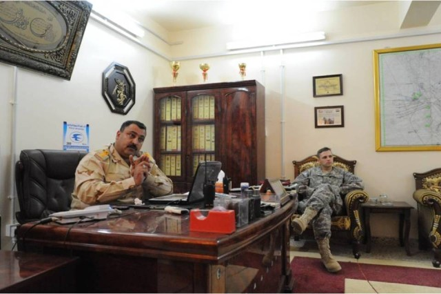 Lt. Col. Salah, commander of the 3rd Battalion, 30th Iraqi Army Division, holds a meeting with Capt. Neil Penttila, the commander of Company C, 1st Battalion, 15th Infantry Regiment, 3rd Heavy Brigade Combat Team, 3rd Infantry Division, in Salah's office at the 3rd Bn.'s headquarters in Najaf Province, Iraq, Feb. 23, 2010. Salah, who was responsible for the province's security during the March 7 National Elections, works closely with his U.S. counterpart to take full of advantage of their technology and specialized expertise.