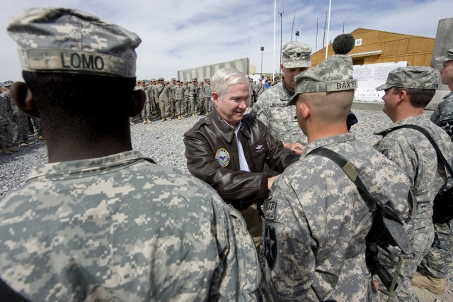 Defense Secretary Robert M. Gates participates in a promotion ceremony during a visit with the Soldiers of 1st Battalion, 17th Infantry Regiment, at a forward operating base in Afghanistan, March 9, 2010.