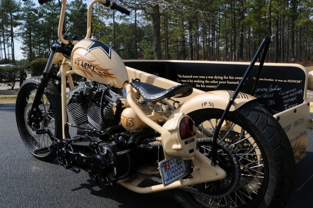 The custom motorcycle built by Sgt. 1st Class Enrique Izquierdo sits in front of the 7th Special Forces Headquarters on Fort Bragg, N.C., before it is presented to Chief Warrant Romulio Camargo.