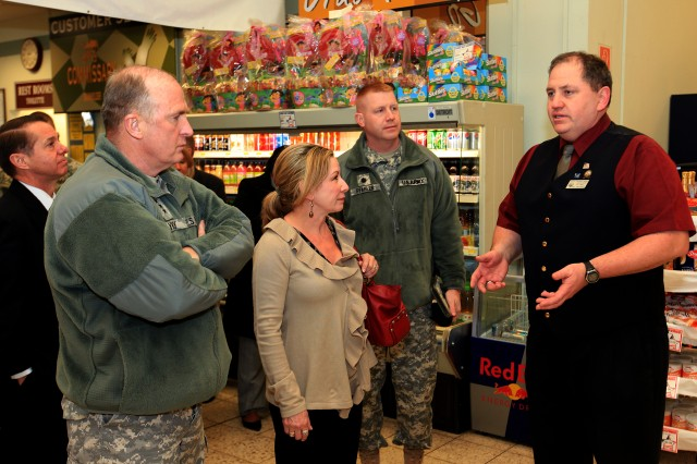 Installation Management Command Commander, Lt. Gen. Rick Lynch (left), his wife Sarah, and Baumholder Garrison Commander, Lt. Col. Paul R. Pfahler, receive a briefing from Baumholder Deputy Commissary Manager Scott Conrey during his visit on March 8. Since taking command in November, this is Lynch's first visit to Europe Army garrisons.