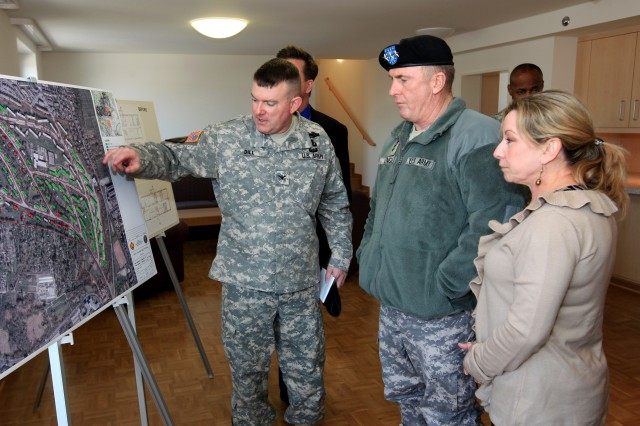 U.S. Army Garrison Wiesbaden Commander, Col. Jeffrey W. Dill briefs Installation Management Command Commander, Lt. Gen. Rick Lynch and his wife Sarah on details of new family housing construction at Aukamm family housing area during their visit to Wiesbaden on March 8.