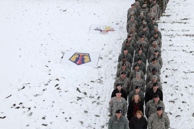 Army Reserve Soldiers of the 7th Civil Support Command and top Army Reserve leaders form a human figure seven formation March 6 at the Daenner Parade Field at Daenner Kaserne. The command formed its first human formation with approximately 150 participants, representing the 7th CSC.