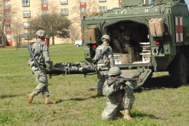 Soldiers of the 232nd Medical Battalion stage a demonstration of the 68W's advanced ability to save lives on the battlefield as part of a ceremony held March 9, on Fort Sam Houston, Texas, recognizing the transformation of combat medics on the modern battlefield.