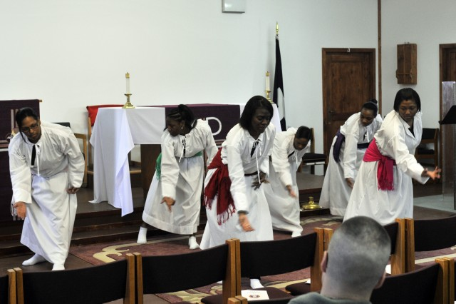Members of the Camp Bondsteel gospel dance team, Heaven's Angels, perform at an ecumenical worship service during the monthly KFOR chaplains' conference Feb. 19.  The conference was hosted by Multi-National Battle Group-East.