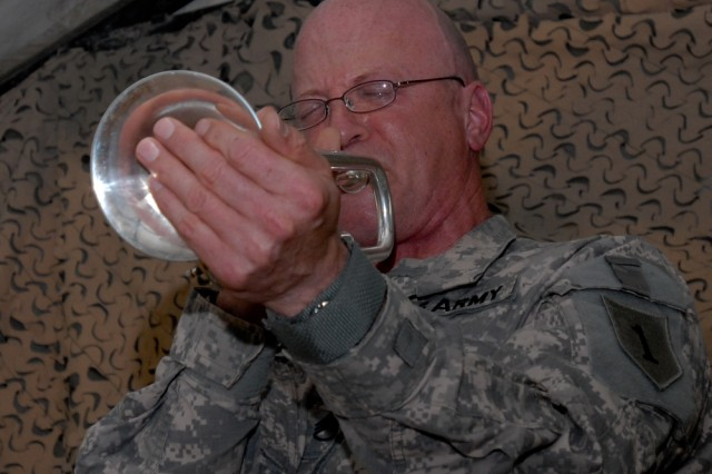 Staff Sgt. Gregory P. Ybarra, of the 1st Infantry Division jazz combo, was part of the March 8 Contingency Operating Base Basra International WomenAca,!a,,cs Day Aca,!Eoesalute to the women of jazzAca,!a,,c presented at Holy JoeAca,!a,,cs coffee house