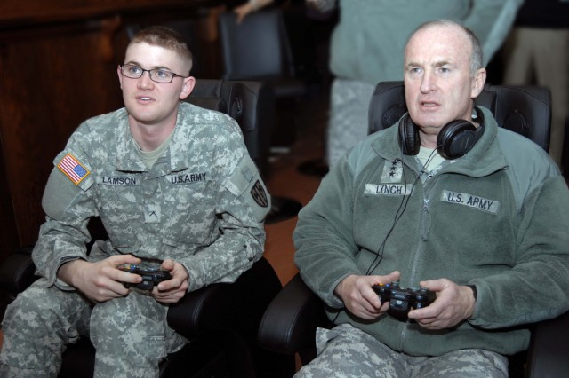 Installation Management Command Commander Lt. Gen. Rick Lynch plays the video game Call of Duty: Modern Warfare II with Pvt. 2 Brian Lamson, the U.S. Army Garrison Kaiserslautern's Better Opportunities for Servicemembers, March 9 at the garrison's new Warrior Zone in the Java Café on Rhine Ordnance Barracks. During his four hour visit to the garrison's footprint, the general also visited wounded warriors at Landstuhl Regional Medical Center.