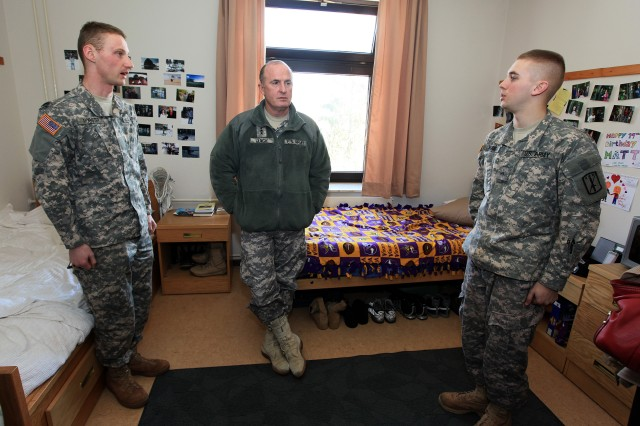 Lt. Gen. Lynch, commander, Installation Management Command, asks Soldiers from 2nd Battalion, 18th Infantry Regiment, 170th Infantry Brigade Combat Team how they like their barracks room and what he can do to improve their living conditions and quality of life. Lynch was in Baumholder April 8 visiting with Soldiers and family members.