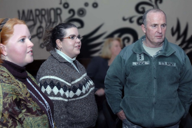 Lt. Gen. Rick Lynch, commander of Installation Management Command, talks to Army spouses during his first visit to U.S. Army Garrison Kaiserslautern March 9 at the garrison's Java Café on Rhine Ordnance Barracks. Pictured with the general are Katie Kratz, left, the 21st Theater Support Command's Headquarters, Headquarters Company Family Readiness Group leader, and Michelle Settle, the Family Readiness Support assistant for the 357th Air and Missile Defense Detachment and 5th Battalion, 7th Air Defense Artillery.