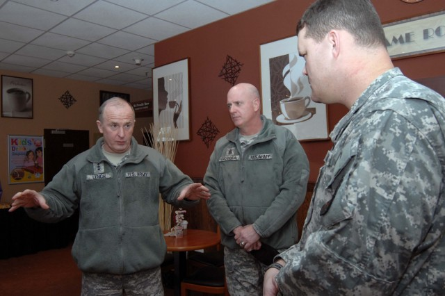 From left: Lt. Gen. Rick Lynch, commander of Installation Management Command,  IMCOM Command Sgt. Maj. Neil Ciotola, and  Lt. Col. Kevin Hutchison, commander of U.S. Army Garrison Kaiserslautern, discuss issues noted by Army spouses in the Kaiserslautern military community March 9.