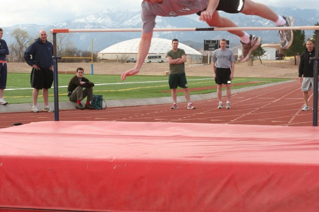 Capt. Christopher Renoll, 304th Military Intelligence Basic Officers Leader Course, flies high, Saturday as he soars over the high jump.