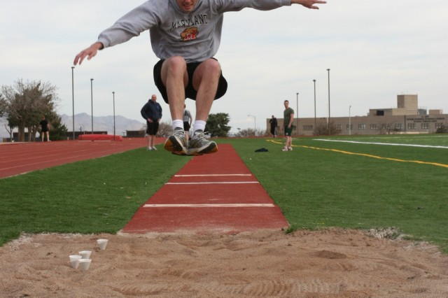 Capt. Christopher Renoll, 304th Military Intelligence Basic Officers Leader Course, competes in the long jump, Saturday on Fort Huachuca. Renoll, along with 10 other Soldiers, is trying to obtain the German Armed Forces Proficiency Badge.
