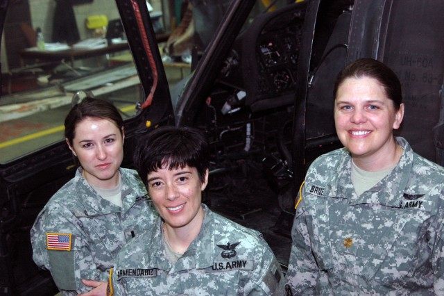 Maj. DeAnna L. Bridenback (right), a UH-60 Black Hawk pilot and commander, C Company, 123rd Aviation Intermediate Maintenance, 16th Combat Aviation Brigade; Chief Warrant Officer Flor Armendariz, battalion aviation maintenance officer, Headquarters Company, 1st Battalion, 52nd Aviation Regiment, 16th CAB; and 1st Lt. Heather Cobb (left), a UH-60 Black Hawk pilot and maintenance platoon leader, C/123rd, are among the women who make up approximately 14 percent of the active Army, according to Army statistics. National Women's History Month highlights the strides that women have made in military service to their country.