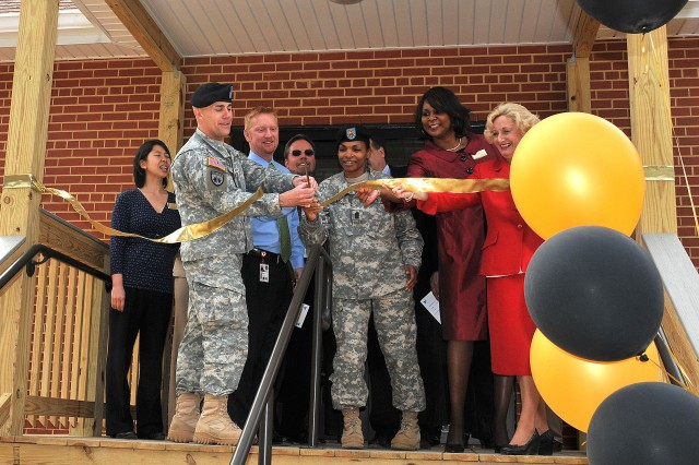 FORT LEE, Va. (March 11, 2010) -- Col. Michael Morrow, Fort Lee garrison commander; Shawn Shelton, project manager; Command Sgt. Maj. June Seay, Fort Lee garrison command sergeant major; Patricia Harper, Family Advocacy Program manager; and Karen McComas, Army Community Service Officer, cut the ribbon for the grand opening of the new FAP addition to the ACS building March 10.