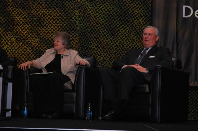 Retired Brig. Gen. Barbara Doornink, senior vice president and operations manager for SAIC Inc., and Bill Kenwell, senior vice president and chief commercial officer for Maersk Line, Ltd., take part in a panel discussion at SDDC's 2010 Training Symposium.
