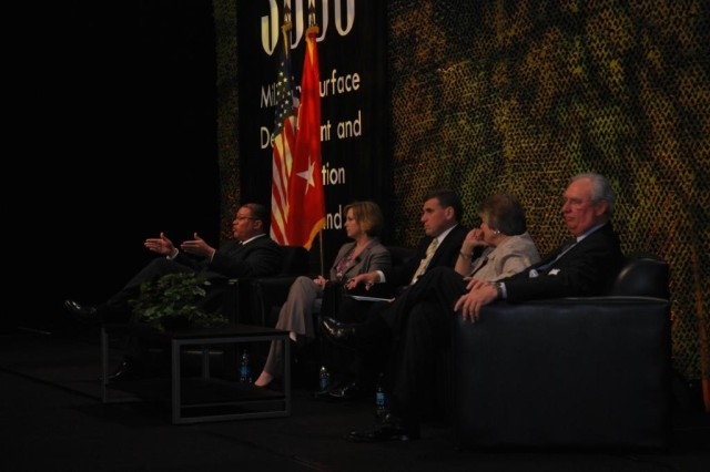 A panel of military and industry leaders discuss the future of the Joint Deployment and Distribution Enterprise, with  Michael K. Williams (left), SDDC's deputy to the commander, moderating.