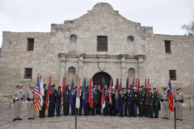 Thirty military personnel representing the Army, Navy, Marine Corps and Air Force participate in the 174th anniversary of the Battle of the Alamo at the Alamo shrine March 6. Service members carried the flags of states and nations representing the known birthplaces of the defenders. One service member, without the flag, represented the unknown defenders who perished. The Alamo Rangers posted and retired colors.