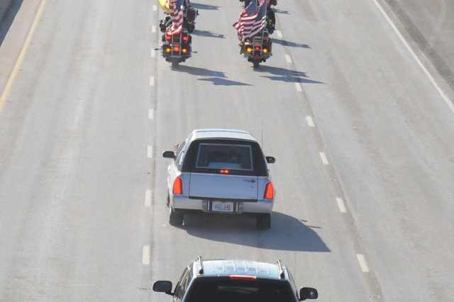 The motorcade was escorted by Kentucky Patriot Guard riders -- in the 20 degree cold--as well as Kentucky State Police.