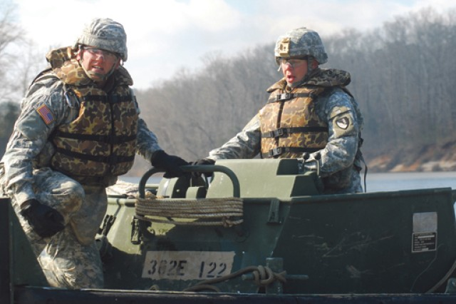 A boat squad picks up a bridge section after it's dropped into the water March 3 along the Chattahoochee River near Lawson Army Airfield. Soldiers with the 362nd Engineer Company (Multi-Role Bridge) participated in a five-day boat school to train and certify their skills in constructing a float bridge.