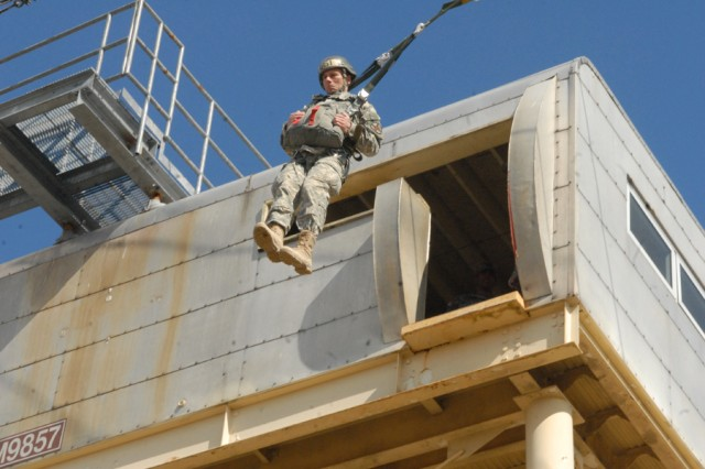 Maj. Douglas Hoover, the Maneuver Center of Excellence Family Life chaplain, exits the 34-foot training tower for the first time during ground week in Airborne School on Fort Benning, Ga.