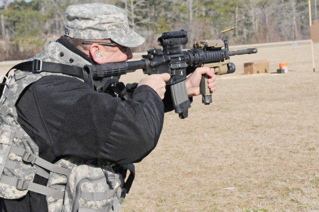 CW5 Bobby Sebren, ASDAT chief, fires an M-4 during training March 5 with the Army Marksmanship Unit at the Privately Owned Weapons Range on Highway 27. ASDAT members received the training in order to protect themselves while investigating aircraft shoot downs.
