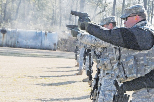 ASDAT members fire pistols during training with the Army Marksmanship Unit. It was the first time ASDAT members received training with the Army's unit from Fort Benning, Ga.