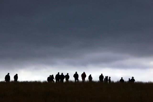 Fort Sill Air Defense Artillery Captains' Career Course students and National Park Service rangers are silhouetted against a threatening Oklahoma sky Friday, Mar. 5, 2010, at the Washita Battlefield National Historic Site near Cheyenne, Okla. The ADA class went on a staff ride to the battlefield and was given access to sites on private land for a better view of the site.