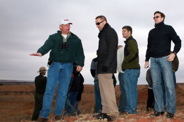 David Christensen (wearing ballcap), Air Defense Artillery command historian, talks about the Washita battle while standing on Custer's Ridge at the  Washita Battlefield National Historic Site near Cheyenne, Okla. The ADA class went on a staff ride to the battlefield and was given access to sites on private land for a better view of the site.