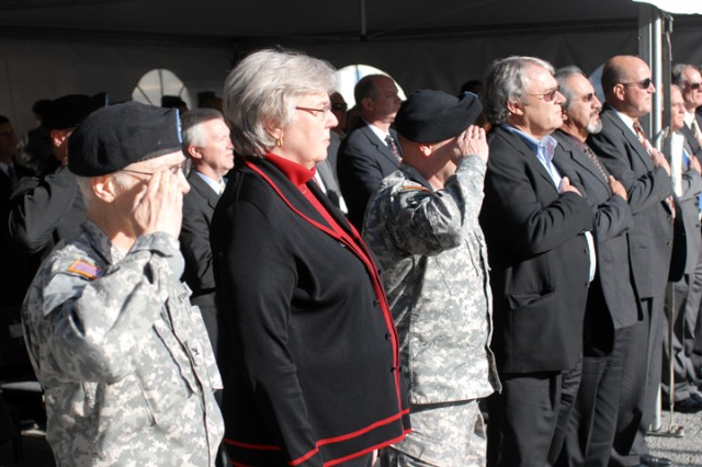 """PRESIDIO OF MONTEREY, Calif. Aca,!"""" Guests stand during the National Anthem at the ground-breaking ceremony here March 10."""