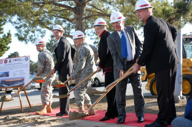 """PRESIDIO OF MONTEREY, Calif. Aca,!"""" Officials participate in the ceremonial shoveling of the soil during the general instruction building ground-breaking event here March 10."""