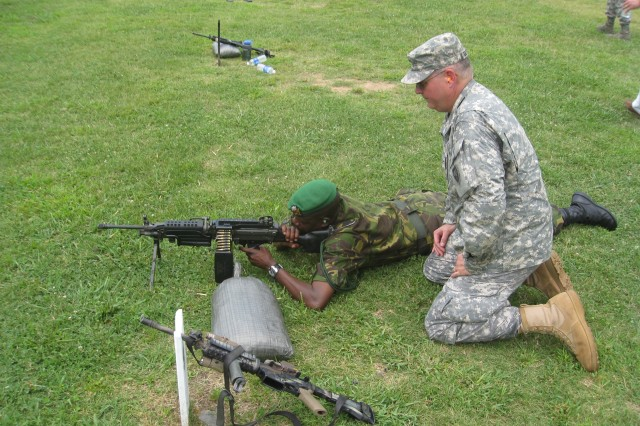 Botswana Defence Force Brig. Gen. George Tlhalerwa fires a squad automatic weapon as Col. Jeffery Brotherton, North Carolina National Guard, observes, Aug. 17, 2009, at the Camp Butner National Guard Training Center in North Carolina. The event, a State Partnership Program initiative, gave a delegation of officers and civilians from Botswana an opportunity to see U.S. training facilities and weapons ranges.
