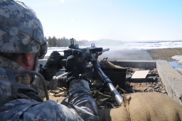 Sgt. David Zeitz peers through the sights of his M2 .50-caliber heavy machine gun during a live-fire qualification on a Fort McCoy, Wis., range. Zeitz is with the 1092nd Engineer Battalion, West Virginia Army National Guard, training to deploy in support of Operation Enduring Freedom.