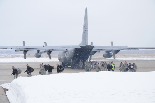 Soldiers from the 1092nd Engineer Battalion deplane at Volk Field from one of the two C-130 aircraft that brought them for their mobilization training at Fort McCoy, Wis. The 1092nd is a West Virginia Army National Guard unit preparing to deploy in support of Operation Enduring Freedom. The C-130s are from the 130th Airlift Wing, West Virginia Air National Guard.