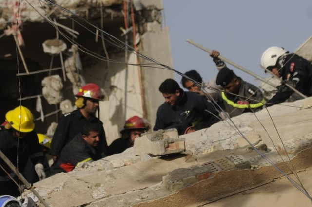 Iraqi first responders work to pull a family of seven from the rubble of their home destroyed by an explosion that killed two local citizens passing by. The blast occurred during the Iraqi parliamentary elections, March 7. Iraqi Army aviators provided over watch as the family was pulled from the rubble with only minor injuries.