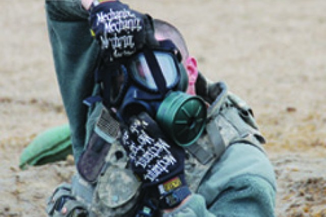 Spc. Stephen Clark, A Co, 88th BSB, 1st MEB, dons his gas mask during a drill March 8 at Fort Polk's Peason Ridge Training Area March 8. The drill tested A Co's Soldiers' ability to put on a gas mask in a prescribed amount of time.