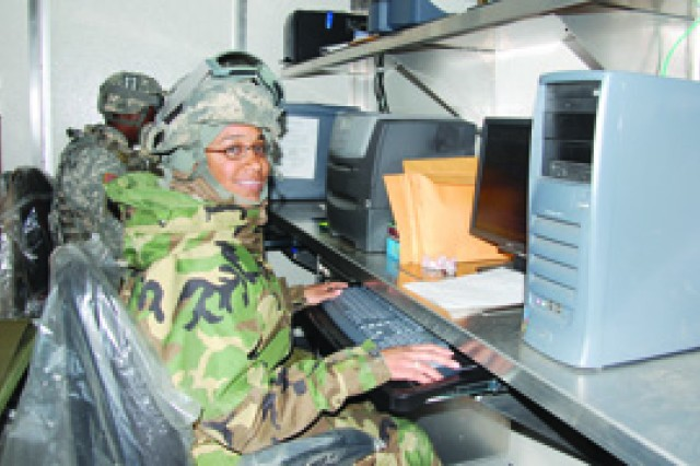 Spc. Karliza Foon, A Co, 88th BSB, 1st MEB, works at a keyboard keeping track of equipment parts during the 88th BSB's field exercise March 8 at Peason Ridge Training Area.