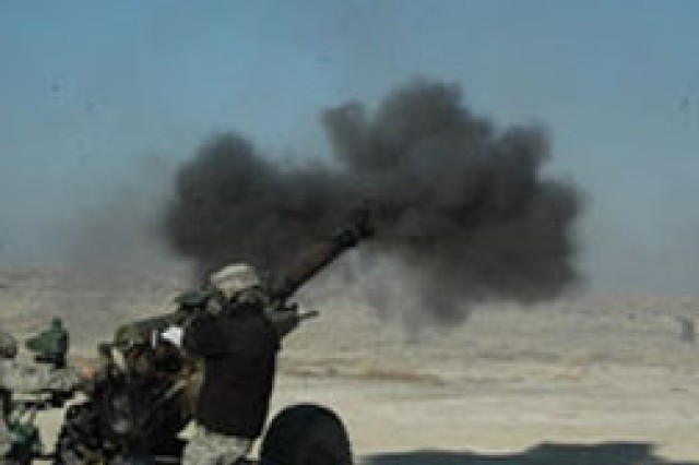 Soldiers from Fort Polk's 5th Battalion, 25th Artillery Regiment, 4th Brigade Combat Team, 10th Mountain Division, fire a 105mm howitzer round during a fire mission at Dugway Proving Ground, Utah, March 1 in preparation for deployment.