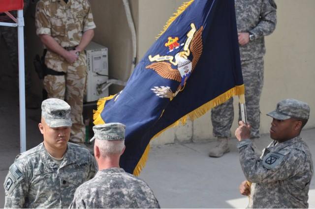 Lt. Col. Michael J. Loos and Command Sgt. Maj. Mio Franceschi uncase the 2nd Battalion, 22nd Infantry Regiment's colors.
