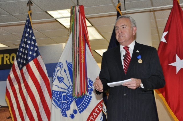"Troy ""Gil"" Gilleland Jr. thanks the men and women, both Soldiers and civilians, he has worked with for their service and support during his time at Army Forces Command. He told them, ""In retirement I think I'll miss most my day-to-day interaction with professionals."" (U.S. Army photo by Larry Stevens, Army Forces Command Public Affairs Office)"