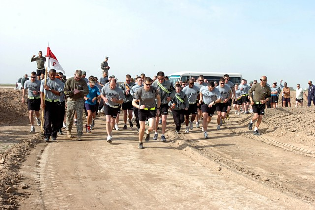 Soldiers and civilians participate in the Contingency Operating Location Sykes Half Marathon Wounded Warrior Project Fundraiser, at COL Sykes, Tal Afar, Iraq, Feb. 24, hosted by the Soldiers of the Tennessee Army National Guard's 1st Squadron, 230th Air Cavalry Squadron, Troop F, Task Force Desperado. The 13.1 mile race raised $4,000 for the Wounded Warrior Project (WWP).  (Photo by: Staff Sgt. Mike Alberts  25th Combat Aviation Brigade Public Affairs)