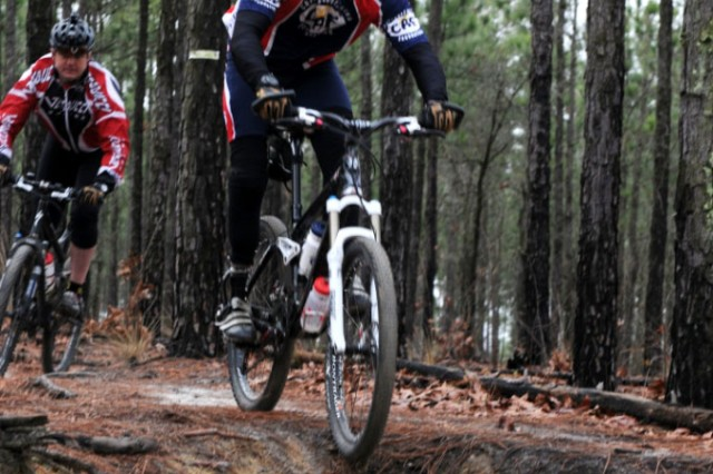Major Kent Solheim, front, executive officer of the 1st Special Warfare Training Group, and Maj. Will Cotty, Operations Officer 1st SWTG, ride through the trails of Smith Lake.  The team has been training and riding to support charities despite Solheim's losing his leg from battle injuries and Cotty having a knee replacement a year ago.