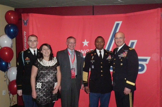 "Maj. Gen. Karl R. Horst, commanding general JFHQ-NCR and The U.S. Army Military District of Washington, attended the Washington Capitals ""Salute to Military Night"" on March 4, 2010. Pictured are right to left: Maj. Gen. Karl R. Horst, CSM Michael Williams, command sergeant major; Mr. Egon Hawrylak, deputy commander; Ms. Gemma Rowe and SGT Arlin Troyer."