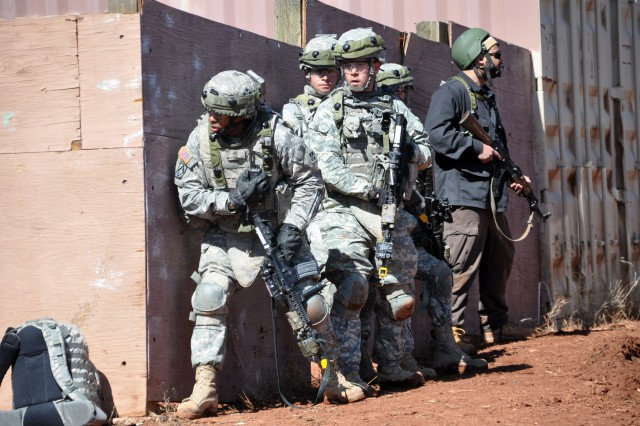 FORT CARSON, Colo.-Staff Sgt. Terrance Potter leads members of the 1st BCT, 4th ID Battalion in preparation for possible enemy fire during training exercises.