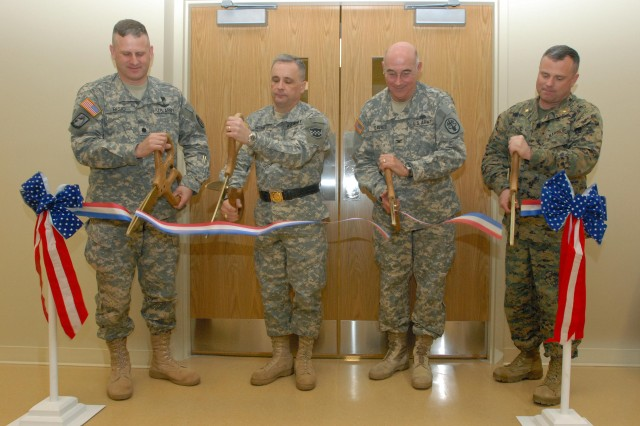 Lt. Col. Andrew J. Riso, acting garrison commander, Fort Detrick; Maj. Gen. William Monk III, commanding general for the 99th Regional Support Command; Col. Jeffery W. Davies, chief of staff for the U.S. Army Medical Research and Materiel Command and Maj. Joe Corbett, USMC, commander, Company B, 4th Light Armored Reconnaissance Battalion cut the ribbon that symbolizes that the Fort Detrick Armed Forces Reserve Center is open for business. The $14-million, 58,600-square-foot Armed Forces Reserve Center and its accompanying Organizational Maintenance Facility located on Fort Detrick's Area B will be the home to the 4th Light Armored Reconnaissance Battalion;  Alpha Company, Detachment 1, 392nd Signal Battalion; 21st and 27th Military History Detachments. (Photo by - Shawn Morris)