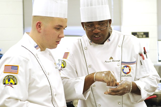 Army Reserve Sgt. Patrick Alveranga, right, gives instructions to his apprentice, Spc. Paul Harmon, Jr. during the Military Chef of the Year event at the 35th U.S. Army Culinary Arts Competition at Fort Lee, Va., Feb. 28, 2010. The Military Chef of the Year is open not only to the Army but the Navy, Marines, Air Force and Coast Guard.