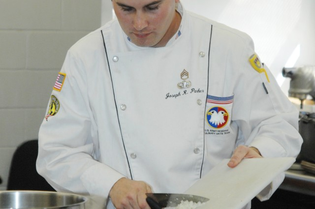 Staff Sgt. Joseph R. Parker dices vegetables for Team U.S. Army Reserve during the March 1 Nutritional Hot Food Challenge portion of the 35th Culinary Arts Competition at Fort Lee, Va.