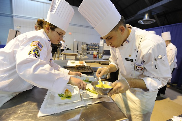 Army Reserve Cpl. Karah Williams, left, and Spc. Daniel Arshadnia plate up during the Student Team Skills event at the 35th U.S. Army Culinary Arts Competition at Fort Lee, Va., March 10. Williams, from Sarcosie, Mo., is assigned to the 414th Military Police Company, Joplin, Mo. Arshadnia, from Lawrence, N.Y., is assigned to the 841st Engineer Battalion based in Miami, Fla.