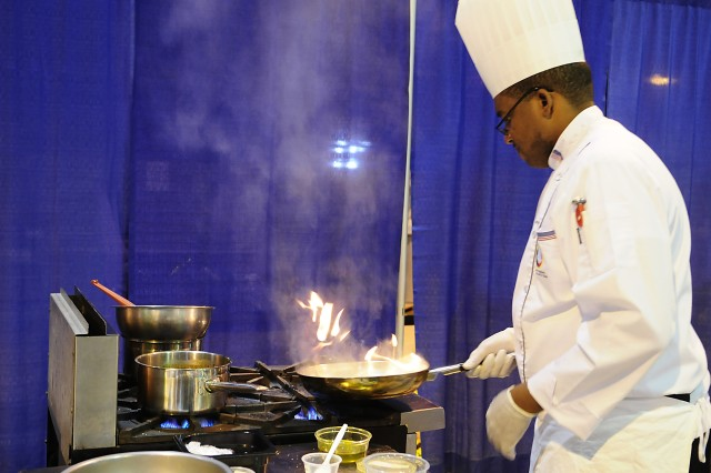 Army Reserve Sgt. Patrick Alveranga heats up the kitchen during the Contemporary Category event at the 35th U.S. Army Culinary Arts Competition at Fort Lee, Va. on Wednesday, March 10, 2010.  Alveranga, from Homestead, Fla., is assigned to the 841st Engineer Battalion based in Miami, Fla.